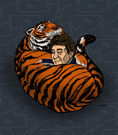 Mr. Ilitch and a tiger cuddling